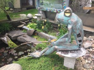 frog fishing sculpture