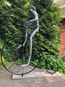 Frog on Bicycle Sculpture